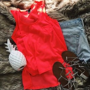 Neon coral sleeveless top with semi sheer back